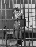 Woman in jail cell Royalty Free Stock Photography