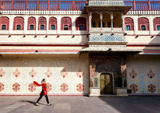 Woman in Jaipur city palace. Woman in red scarf walking on the square in City Palace of Jaipur, Rajasthan, India royalty free stock photos