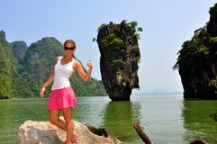 Woman at James Bond Island. Woman standing next to a landmark from a james bond movie (James Bond island Royalty Free Stock Photography