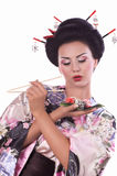 Woman in Japanese kimono with chopsticks and sushi roll Royalty Free Stock Photo
