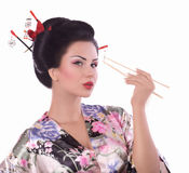 Woman in Japanese kimono with chopsticks and sushi roll Stock Photos