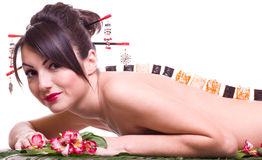 Woman with Japanese sushi rolls. Young beautiful woman with Japanese sushi rolls, isolated on white background Royalty Free Stock Photography