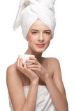 Woman with jar of moisturizing cream Royalty Free Stock Photos