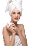 Woman with jar of moisturizing cream Royalty Free Stock Photos
