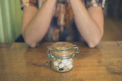 Woman with jar of sugar at table Stock Photos