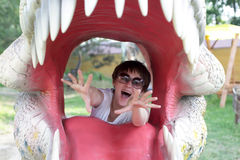 Woman in jaws of dinosaur Royalty Free Stock Photos