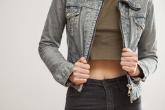 Woman jean jacket on gray background Stock Images