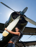 Woman in jeans and aircraft Stock Image