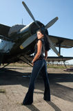 Woman in jeans and aircraft Royalty Free Stock Images