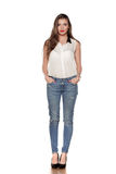 Woman in jeans. Beautiful young woman in jeans and sleeveless shirt on a white background Stock Images