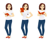 Woman in jeans with book Stock Photography