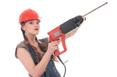 Woman in jeans coverall holding perforator drill Royalty Free Stock Photo