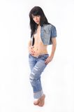 Woman in jeans and denim coat Royalty Free Stock Photo