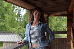 Woman in jeans and a denim jacket Royalty Free Stock Photo