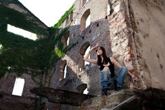 There you are!. Woman in jeans in a deserted building looking to see if there is somebody coming royalty free stock photos