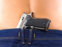 Woman in jeans and gun Stock Image