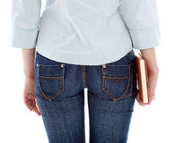 Woman in jeans holding book Stock Photo