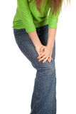 Woman in jeans with knee pain Royalty Free Stock Photography