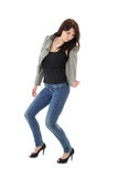 Woman in jeans and leather jacket dancing Royalty Free Stock Photography