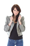 Woman in jeans and leather jacket over white Stock Photos