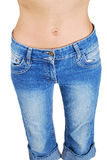 Woman in jeans with sexy belly Royalty Free Stock Photo