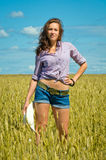 A woman in jeans shorts with cowboy hat in hand Royalty Free Stock Photo