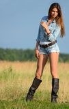 The woman in jeans shorts in the field Stock Photos