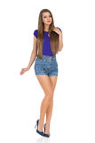 Woman In Jeans Shorts And High Heels Stock Image