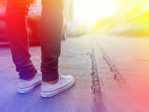 Woman jeans and sneaker shoes. Royalty Free Stock Photography