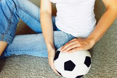 Woman in jeans with soccer ball stock images