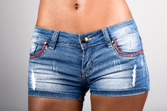 Woman in jeans texas shorts Royalty Free Stock Image