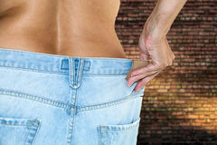Woman with jeans topless making diet Royalty Free Stock Images
