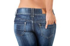 Woman in jeans. A young sexy woman is wearing blue jeans. Rear view Stock Photo