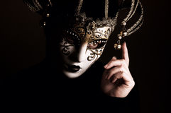 Woman with Jester mask Royalty Free Stock Photography