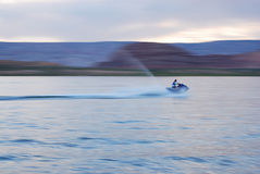 Woman on Jetski Motion Blur. Motion bur of a woman jetskiing on Lake Powell in the evening Royalty Free Stock Photo