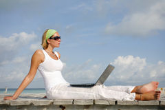 Woman on Jetty with Laptop Stock Photos
