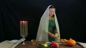 A woman of a breaks a freshly baked hala into pieces. Overall plan stock video