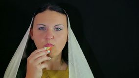A woman is a eating an apple in honey. stock video