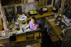 Woman Jeweller at Workbench Stock Images