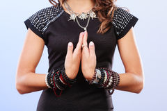 Woman with jewellery in black evening dress Royalty Free Stock Images