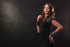 Woman with jewellery in black evening dress Royalty Free Stock Photos