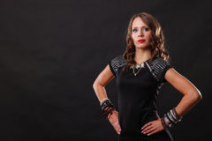 Woman with jewellery in black evening dress Stock Images