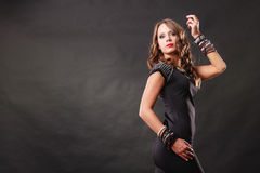 Woman with jewellery in black evening dress Stock Photos