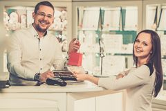 Woman in a jewellery shop Royalty Free Stock Photos