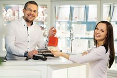Woman in a jewellery shop Royalty Free Stock Images