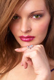 The woman and jewelry Stock Images