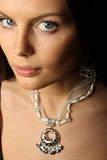 Woman and jewelry. Portrait of elegant beautiful woman wearing jewelry Stock Image