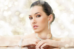 Woman with jewelry Royalty Free Stock Image