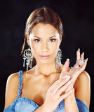 Woman with jewelry Stock Images