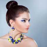 Woman in jewelry of pansies Royalty Free Stock Photo
